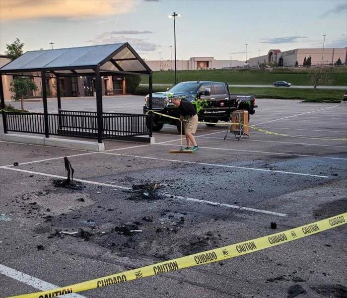 fire debris in a commercial parking lot due to a car fire